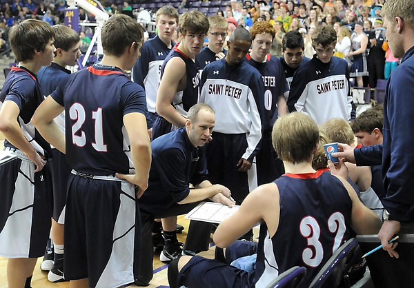 Pat Christman<br /> St. Peter coach Sean Keating draws up a play for his team during a time out Friday.