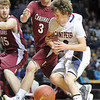 Pat Christman<br /> St. Peter's Brendan Reese has the ball knocked out of his hand by Fairmont's Mitch Pfingsten during the first half of their State Class AA quarterfinal game Wednesday at the University of Minnesota's Williams Arena.