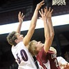 Pat Christman<br /> St. Peter's Kolin Bartlett (50) and Fairmont's Josh Eversman leap for a rebound during the second half of their State Class AA quarterfinal game Wednesday at the University of Minnesota's Williams Arena.