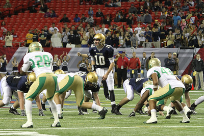 St. Pius quarterback Jack Spear (#10) hollers out instructions before the offense runs a play in the third quarter.