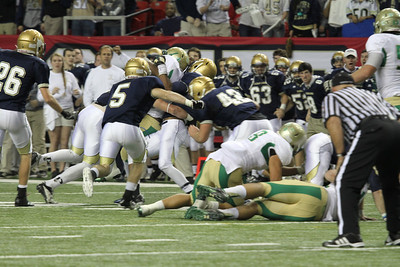 The St. Pius defense gang tackles a Buford running back for little or no gain.