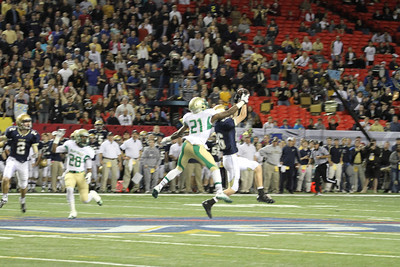 St. Pius wide receiver Matt Pearson (#26) catches a fourth quarter pass over Buford defensive back Thomas Wilson (#21).