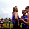 "Boulder High runners Sam Lewis, (center) and Madi Lohmann (right), help Luisa Jaeger take off her bib number after the varsity race of the St. Vrain Cross Country Invitational at Lyons Middle-Senior High School in Lyons, Saturday, Sept. 12, 2009. The invitational brought teams from all over Colorado to compete.<br /> <br /> For more photos please visit  <a href=""http://www.dailycamera.com"">http://www.dailycamera.com</a><br /> <br />  DAILY CAMERA/Kasia Broussalian"
