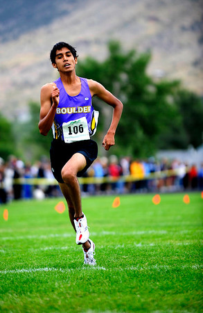 """Boulder High senior Dominic Cabada runs through the finish line in second place at the varsity race of the St. Vrain Cross Country Invitational at Lyons Middle-Senior High School in Lyons, Saturday, Sept. 12, 2009. The invitational brought teams from all over Colorado to compete.<br /> <br /> For more photos please visit  <a href=""""http://www.dailycamera.com"""">http://www.dailycamera.com</a><br /> <br />  DAILY CAMERA/Kasia Broussalian"""