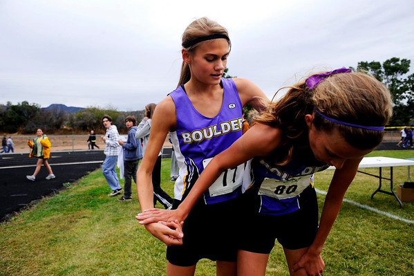 """Boulder High Junior Kelsey Lakowske comforts teammate Sam Lewis, a sophomore, after finishing first and third, respectively, for the varsity race of the St. Vrain Cross Country Invitational at Lyons Middle-Senior High School in Lyons, Saturday, Sept. 12, 2009. The invitational brought teams from all over Colorado to compete.<br /> <br /> For more photos please visit  <a href=""""http://www.dailycamera.com"""">http://www.dailycamera.com</a><br /> <br />  DAILY CAMERA/Kasia Broussalian"""