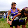 "Boulder High Junior Kelsey Lakowske comforts teammate Sam Lewis, a sophomore, after finishing first and third, respectively, for the varsity race of the St. Vrain Cross Country Invitational at Lyons Middle-Senior High School in Lyons, Saturday, Sept. 12, 2009. The invitational brought teams from all over Colorado to compete.<br /> <br /> For more photos please visit  <a href=""http://www.dailycamera.com"">http://www.dailycamera.com</a><br /> <br />  DAILY CAMERA/Kasia Broussalian"