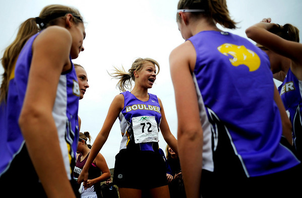 """Boulder High Sophomore Luisa Jaeger jumps to rid her nerves before the start the varsity race of the St. Vrain Cross Country Invitational at Lyons Middle-Senior High School in Lyons, Saturday, Sept. 12, 2009. The invitational brought teams from all over Colorado to compete.<br /> <br /> For more photos please visit  <a href=""""http://www.dailycamera.com"""">http://www.dailycamera.com</a><br /> <br />  DAILY CAMERA/Kasia Broussalian"""