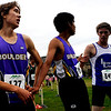 "Boulder High runners Ryder Tan (left) and Dominic Cabada congratulate themselves and others after finishing the varsity race of the St. Vrain Cross Country Invitational at Lyons Middle-Senior High School in Lyons, Saturday, Sept. 12, 2009. The invitational brought teams from all over Colorado to compete.<br /> <br /> For more photos please visit  <a href=""http://www.dailycamera.com"">http://www.dailycamera.com</a><br /> <br />  DAILY CAMERA/Kasia Broussalian"