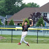 North Clay's Logan Fleener jumps after making a catch during a baseball game against Effingham (St. Anthony) in the Class 1A Sectional 6 Regional Finals on Monday, July 7, 2021, at Evergreen Hollow Park, in Effingham, Illinois. (Alex Wallner/Effingham Daily News)