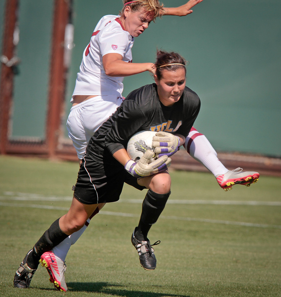 UCLA goalie grabs the ball away from Stanford's Shelby Payne in women's soccer at Cagan Stadium at  Stanford, Calif., on Sunday, October 9, 2011.