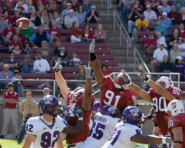 The defense leaps for the ball.