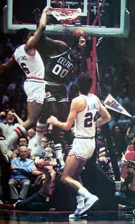 Now this is a facial. Dr. J giving Robert Parish a facial dunk during the 1981 season.