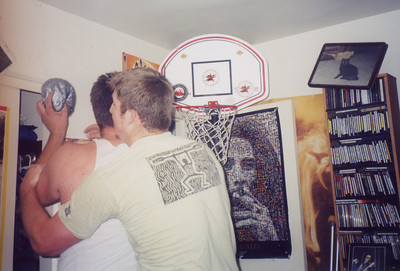 Zach up goes up on a worthy defender. Notice the picture falling off the wall as over thirteen feet of men go at it.