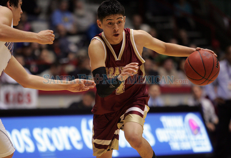 Antione Salazar, of Santa Fe Indain School, drives down the court as Sandia Prep's boys basketball team beat the Braves, 56-50, during the semifinals of state basketball play at the Pit in Albuquerque, N.M. on Mar. 12, 2010. <br /> Natalie Guillén/The New Mexican