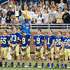 Record-Eagle/Jan-Michael Stump<br /> Traverse City St. Francis players and fans stand for the national anthem before the start of their state title game against Ubly Saturday in Detroit.