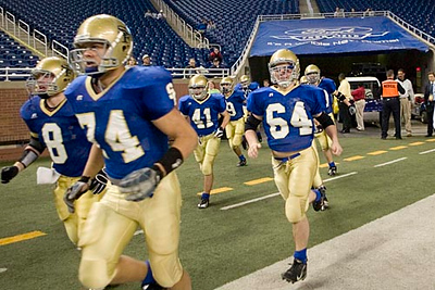 Record-Eagle/Jan-Michael Stump<br /> Traverse City St. Francis run onto Ford Field before the start of their state title game against Ubly Saturday in Detroit.