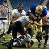 Record-Eagle/Jan-Michael Stump<br /> Traverse City St. Francis running back Joe Kerridge (8) gets hit by Ubly's Jordan Kaufman (5), Justin Cleary (28) and Steven Weber (88) near the goal line in the first quarter of Saturday's state final game at Ford Field in Detroit.