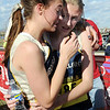 Sisters Kat Robinson, left, and Kelley hug each other at the Nederland runners finished the girls 2A race at the state cross country meet at Fossil Ridge High School in Ft. Collins on Saturday.<br /> <br /> November 7, 2009<br /> Staff photo/David R. Jennings