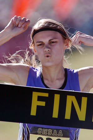 Kelsey Lakowske, Boulder, reacts while crossing the finish line for a  first place in the girls 5A race at the state cross country meet at Fossil Ridge High School in Ft. Collins on Saturday.<br /> <br /> November 7, 2009<br /> Staff photo/David R. Jennings