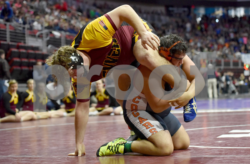 -Messneger photo by Britt Kudla<br /> Enrique Maravilla of Manson NW Webster wrestles against Denver Brock Farley during Class 1A quarter finals on Friday inside Wells Fargo Arena