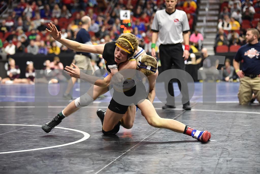 -messenger photo by Britt Kudla<br /> Spencer Griffin of Emmetsburg wrestles against Gable Fox during class 1A semi-finals on Friday