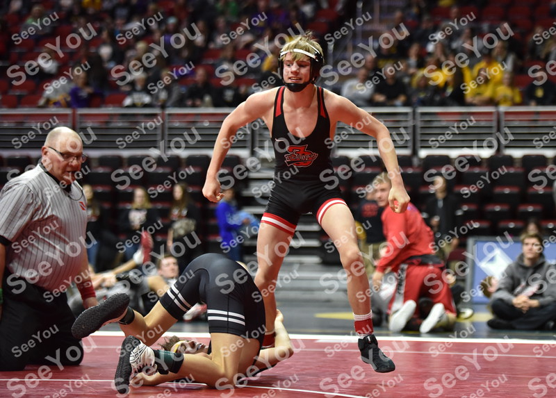 -Messenger photo by Britt Kudla<br /> Carson Taylor of Fort Dodge celebrates after pinning Waukee Nick Miller during Class 3A Quarterfinals on Wednesday at Wells Fargo Arena