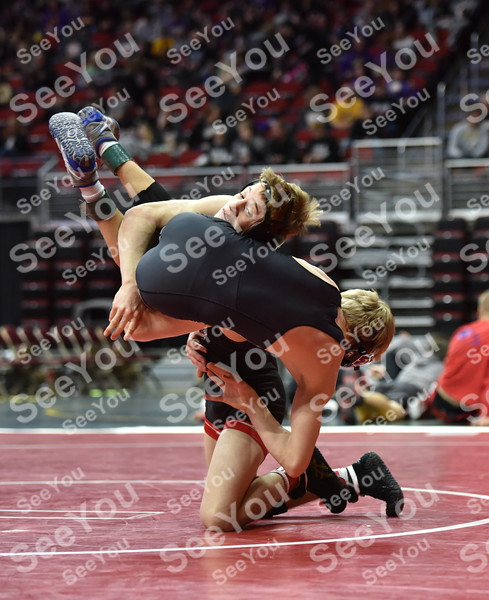 -Messenger photo by Britt Kudla<br /> Lane Cowell of Fort Dodge wrestles against Connor Kelly during Class 3A Quarterfinals Duals on Wednesday at Wells Fargo Arena