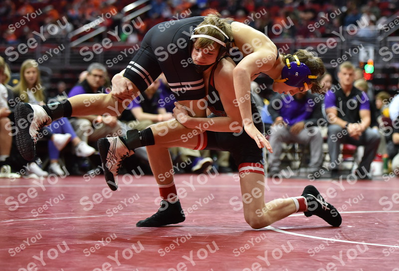 -Messenger photo by Britt Kudla<br /> Carson Taylor of Fort Dodge wrestles against Waukee Nick Miller during Class 3A Quarterfinals on Wednesday at Wells Fargo Arena