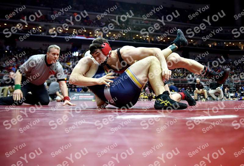 -Messenger photo by Britt Kudla<br /> Garret Bruce of East Garret County attempts to pin English Valley Caleb Peach during Class 1A State Wrestling on Wednesday at Wells Fargo Arena