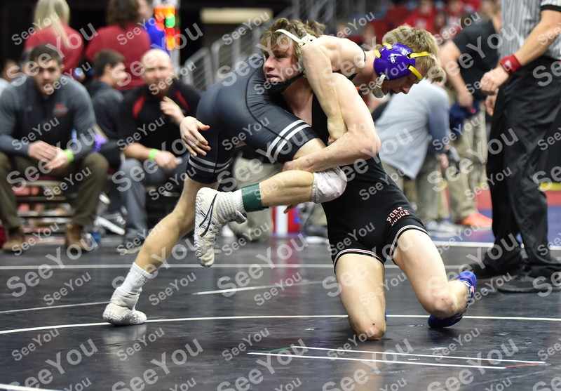 -Messenger photo by Britt Kudla<br /> Brooks Cowell of Fort Dodge wrestles against Waukee Carter Smith during Class 3A State Wrestling on Wednesday