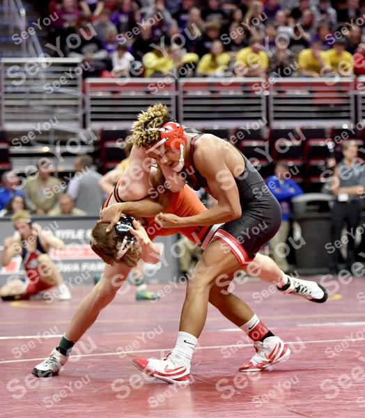 -Messenger photo by Britt Kudla<br /> Drevon Ross of Fort Dodge wrestles against Waverly-Shell rock during Class 3A State Wrestling on Wednesday at Wells Fargo Arena