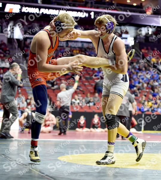 -Messenger photo by Britt Kudla<br /> Chase McAlister of South Central Calhoun wrestles against Colfax-Mingo Trystin Ross during class 1A consolation on Thursday at Wells Fargo Arena