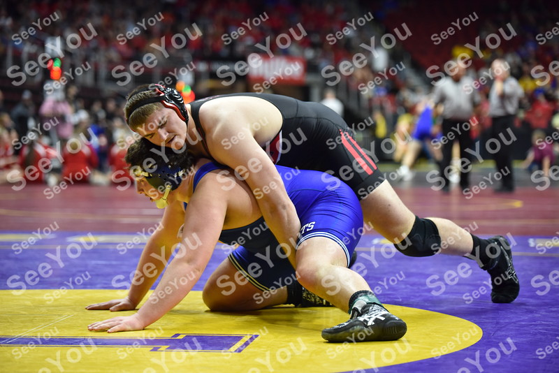 -Messenger photo by Britt Kudla<br /> Spencery Trenary of Clarion-Goldfield/Dows wrestles gainst Crestwood Stone Peckham during Class 2A state wrestling on Thursday