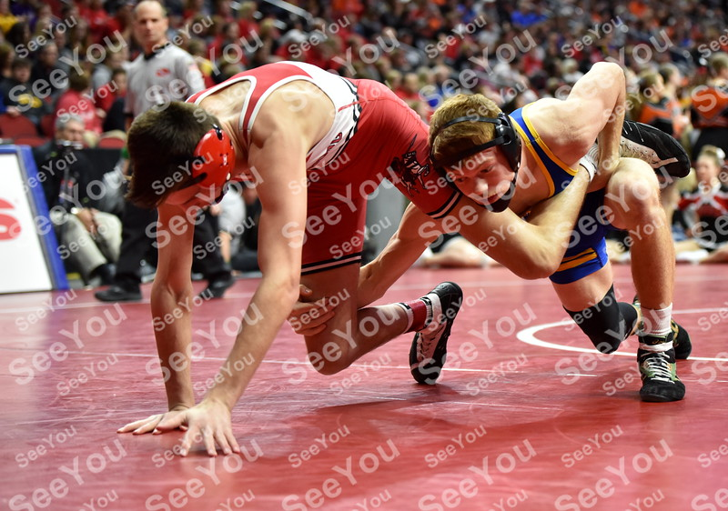 -Messenger photo by Britt Kudla<br /> Joey Buss of Humboldt wrestles against Williamsburg Garrett Jensen during class 2A state wrestling on Thursday