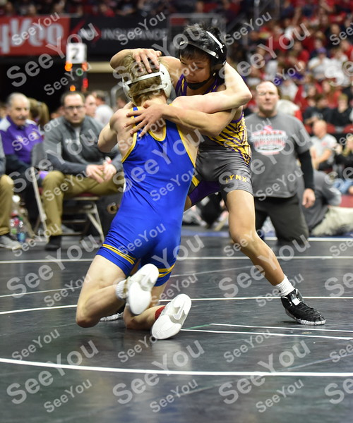 -Messenger photo by Britt Kudla<br /> Camron Phetxoumphone of Webster City wrestles against Humboldt Cole Nelson during Class 2A state wrestling on Thursday at Wells Fargo Arena