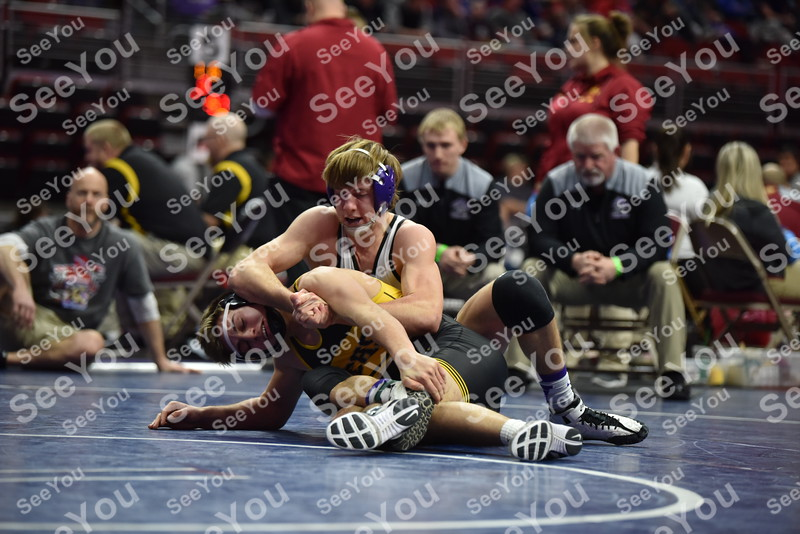 -Messenger photo by Britt Kudla<br /> Chase McAlister of South Central Calhoun wrestles against Tri-Central Bryson Freeberg during Class 1A consolation on Friday