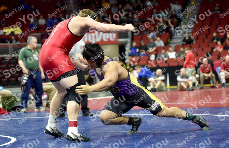 -Messenger photo by Britt Kudla<br /> Joel Mendoza of Eagle Grove wrestles against Postville Isaac Steffans during class 1A consolation of Friday
