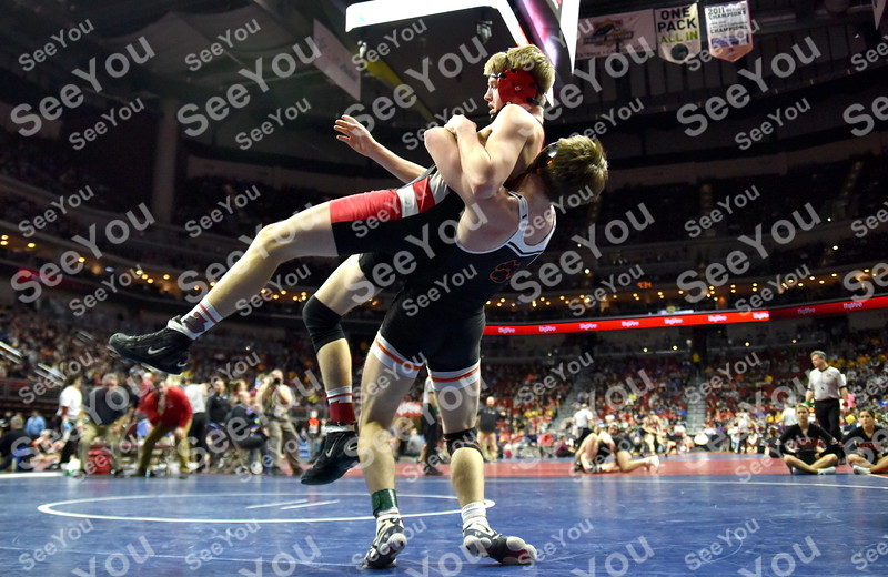 -Messenger photo by Britt Kudla<br /> Kody Cook of Fort Dodge wrestles against West Des Moines Valley Caleb Corbin during class 3A Quarterfinals on Friday at Wells Fargo Arena