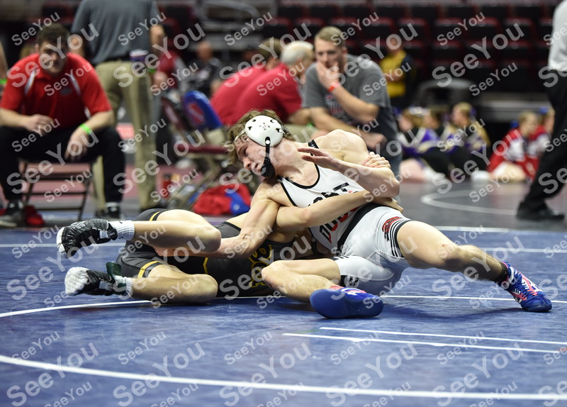 -Messenger photo by Britt Kudla<br /> Brooks Cowell of Fort Dodge wrestles against Betterdorf Kohler Ruggles during class 3A consolations on Friday