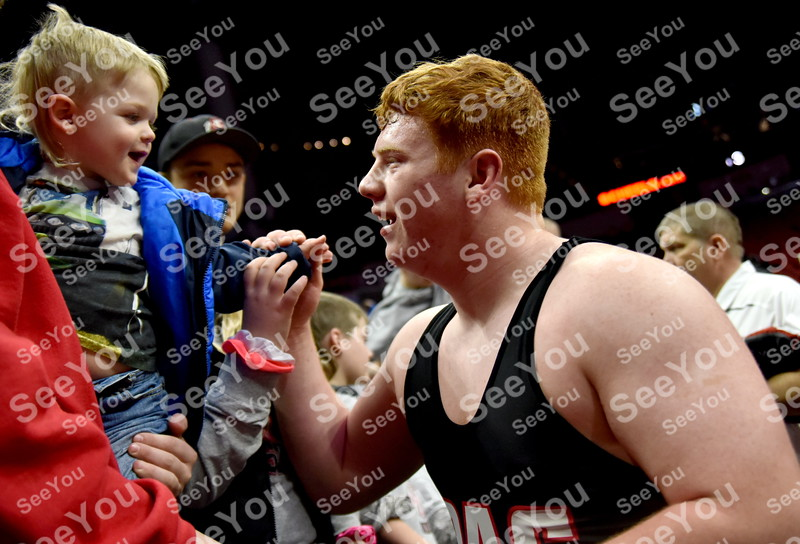 -Messenger photo by Britt Kudla<br /> Dane Johnson of Pocahontas Area gives his 2 year old cousin Rigin Frimuth a hug after defeating Louisa Muscatine Gabe Hayes during 1A consolation on Friday in Des Moines