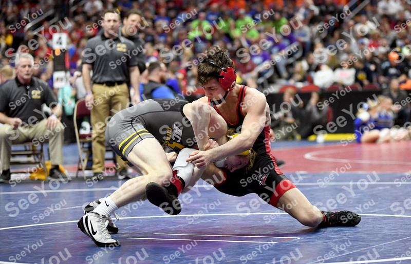-Messenger photo by Britt Kudla<br /> Nate Thomsen of East Sac County wrestles against AcGC Gunnar Larsen during Class 1A state tournament on Thursday in Des Moines