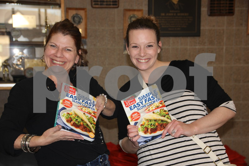 On Thursday, April 14, 2016, Taste Of Home Cooking School came to the Iowa Central Community College campus in Fort Dodge. There was something for everyone to enjoy. The evening also included a VIP dinner prepared by the Iowa Central Community College Culinary Arts students. Shown here left to right is: Monica Klinkefus and Amanda Geopfert, who helped out greeting attendees and pointing them in the right direction. Here they are showing one of the books  on sale at the event.