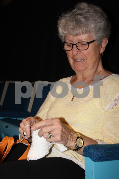 On Thursday, April 14, 2016, Taste Of Home Cooking School came to the Iowa Central Community College campus in Fort Dodge. There was something for everyone to enjoy. The evening also included a VIP dinner prepared by the Iowa Central Community College Culinary Arts students. Shown knitting  while waiting for the cooking show to begin is: Janet Kinne. She was one of several attendees.