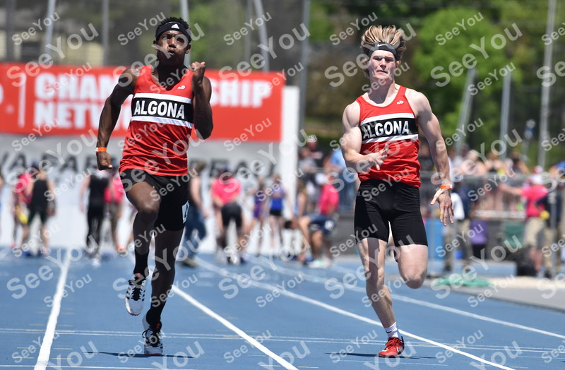 -Messenger photo by Britt Kudla<br /> Algona Samonte Bawden (left) and Wyatt Wegener compete during Class 3A 100 Meter Dash on Thursday in Des Moines