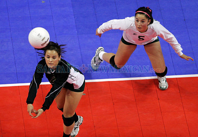 (L-R) Mequella Lovato and Kiana Vigil of Pojoaque, against Portales for the AAA championship during the New Mexico State Volleyball tournament at the Santa Ana Star Center in Rio Ranch, N.M. on Nov 13, 2009. The Elkettes won in four games.  Natalie GuillŽn/The New Mexican