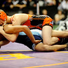 Erie's Casey Crescentini (top) wrestles Trinidad's Richard Baca for the 119-pound match during the first round of the 3A State Wrestling Tournament at the Pepsi Center in Denver, Thursday, Feb. 18, 2010. <br /> KASIA BROUSSALIAN