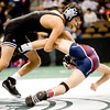 Fairview's Chris Chavez (left) wrestles Chaparral's Keaton Reed for the 112-pound match during the first round of the 5A State Wrestling Tournament at the Pepsi Center in Denver, Thursday, Feb. 18, 2010. <br /> KASIA BROUSSALIAN