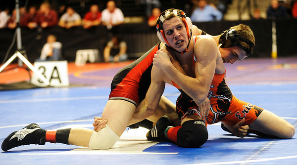 Erie's Austin Banks (front) wrestles Centauri's Jared Holman for the 145-pound during the first round of the 3A State Wrestling Tournament at the Pepsi Center in Denver, Thursday, Feb. 18, 2010. <br /> KASIA BROUSSALIAN