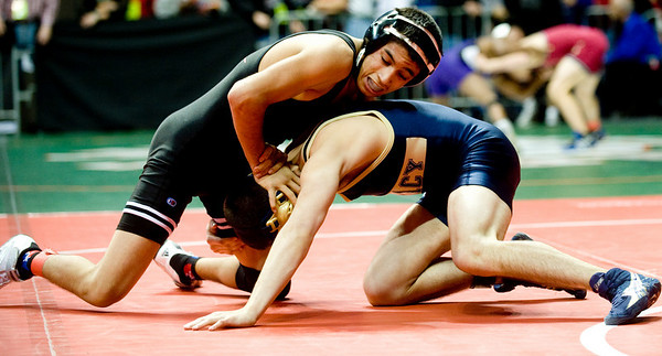 Fairview's Michael Chavez (left) is tipped by Legacy's Mark Dubberly for the 119-pound match during the first round of the 5A State Wrestling Tournament at the Pepsi Center in Denver, Thursday, Feb. 18, 2010. <br /> KASIA BROUSSALIAN