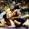 Lyon's Ryan Valadez (right) wrestles Olathe's Zach Stansberry for the 160-pound match during the first round of the 3A State Wrestling Tournament at the Pepsi Center in Denver, Thursday, Feb. 18, 2010. <br /> KASIA BROUSSALIAN